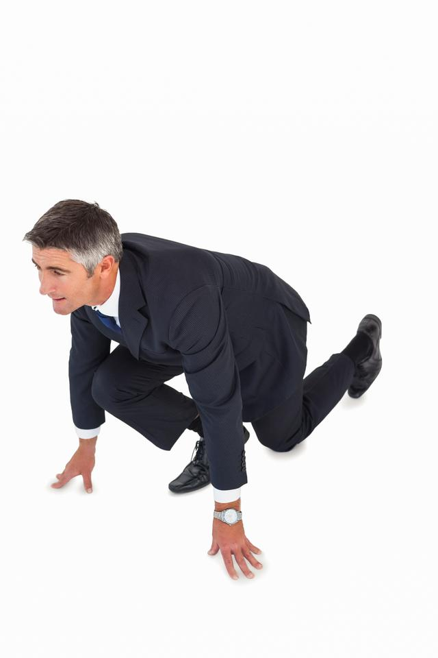 """""""Businessman with hands and one knee on the floor"""" stock image"""