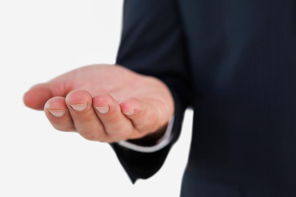 """""""Close up of a businessman with hand out"""" stock image"""