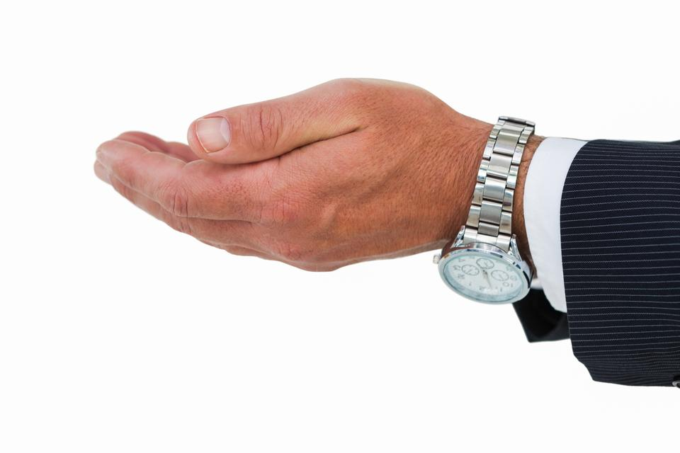 """""""Businessman with wrist watch and hands out"""" stock image"""