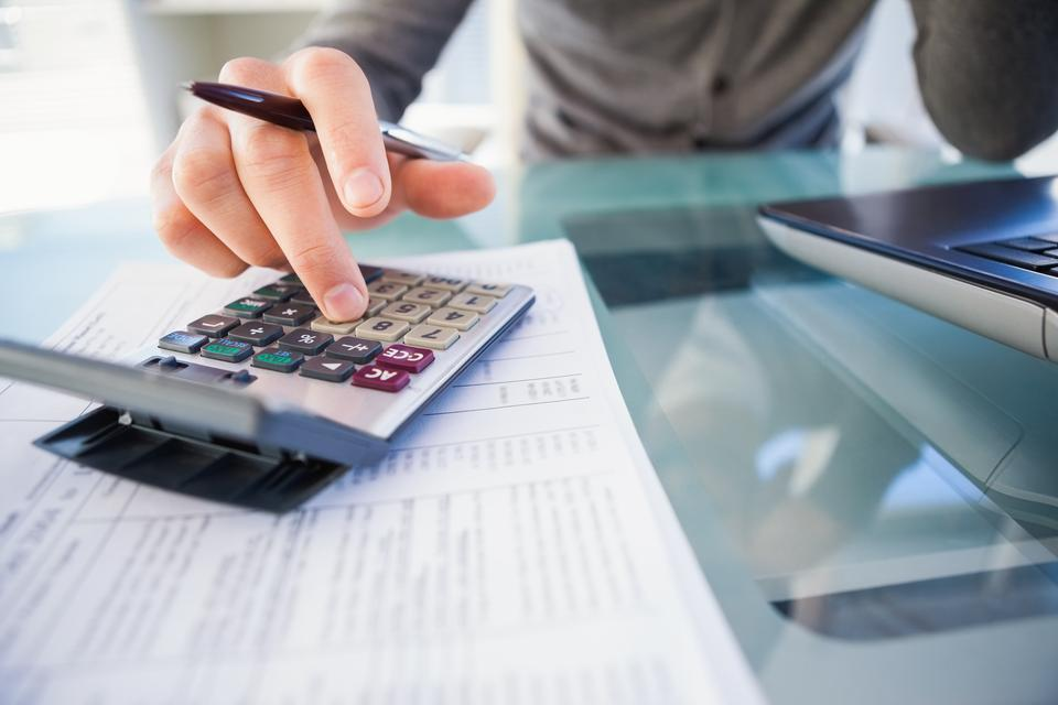"""""""Casual businessman calculating his expenses"""" stock image"""
