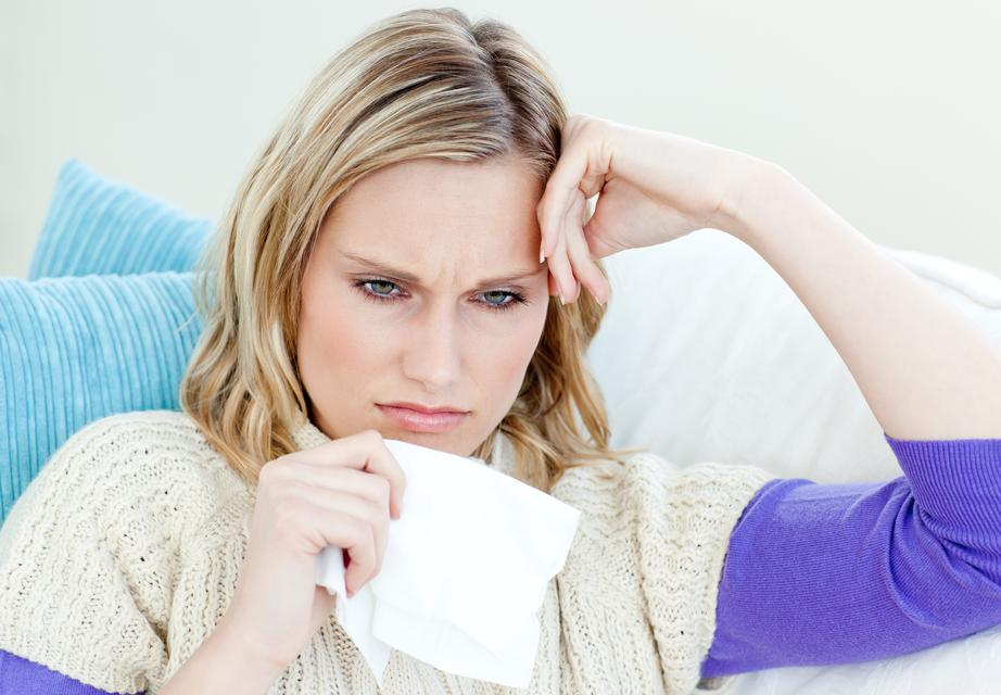 """""""Diseased woman lying on a sofa with tissues"""" stock image"""