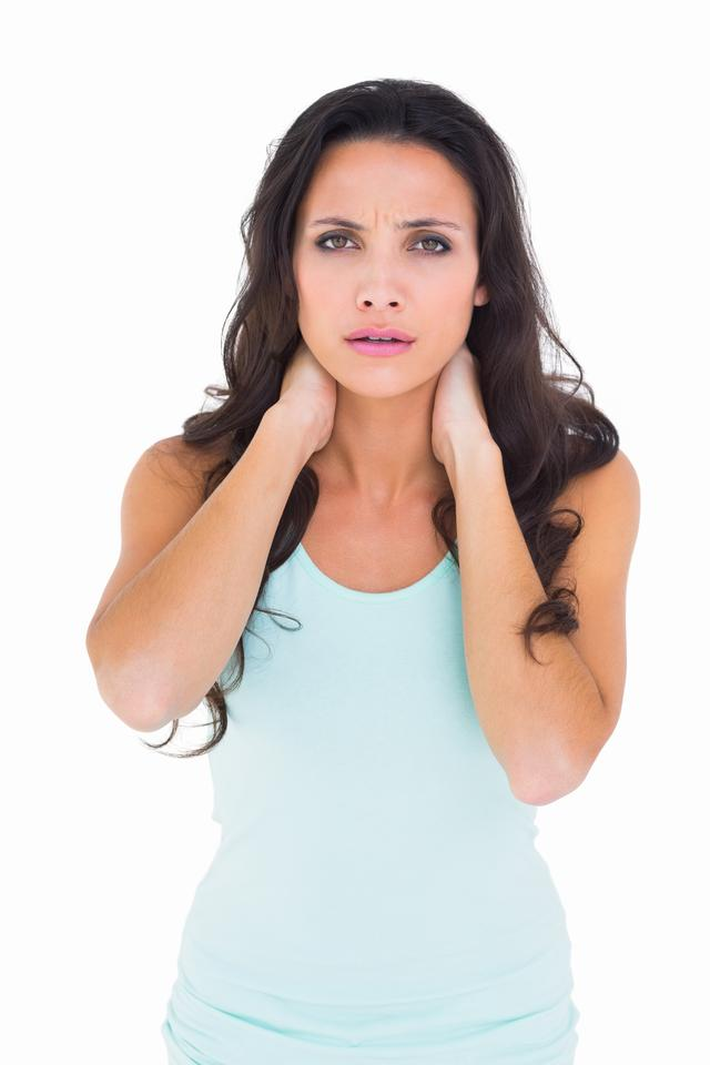 """Pretty brunette with a sore neck"" stock image"