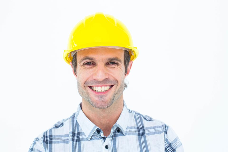 """Architect wearing hardhat over white background"" stock image"