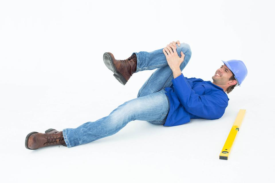 """""""Architect suffering from knee pain"""" stock image"""