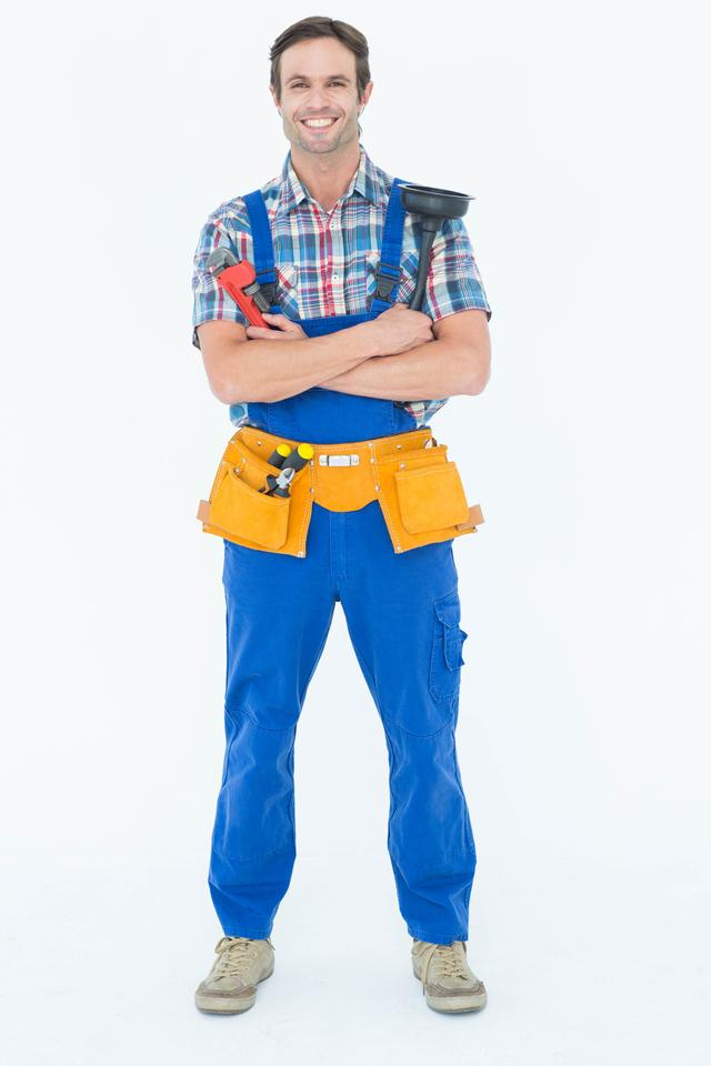 """Confident plumber holding monkey wrench and plunger"" stock image"