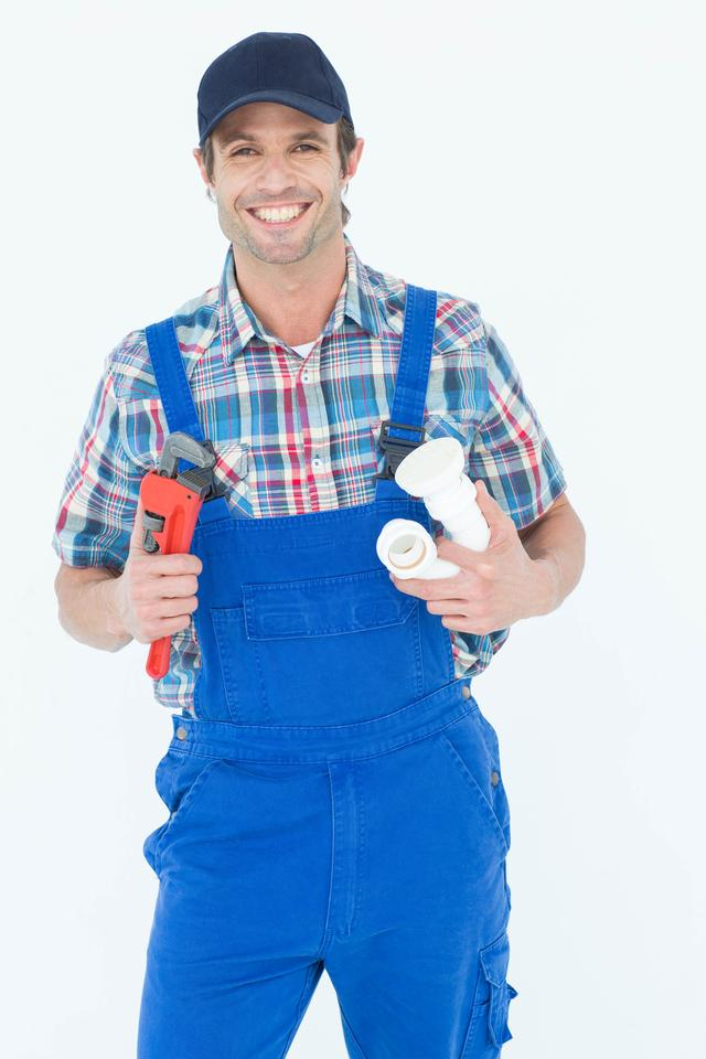 """Plumber holding monkey wrench and sink pipe"" stock image"