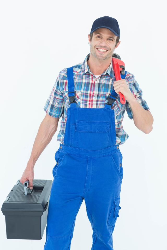 """Plumber with monkey wrench and tool box"" stock image"