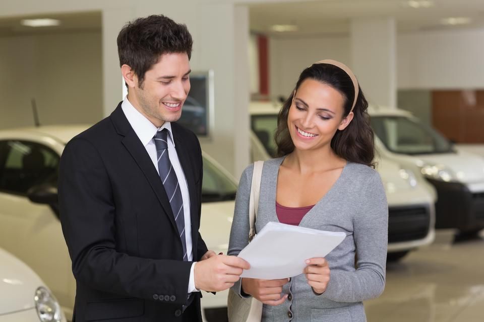 """""""Salesperson showing clipboard to sign to customer"""" stock image"""