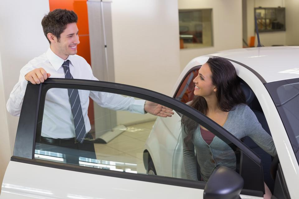 """""""Salesperson speaking with happy client"""" stock image"""