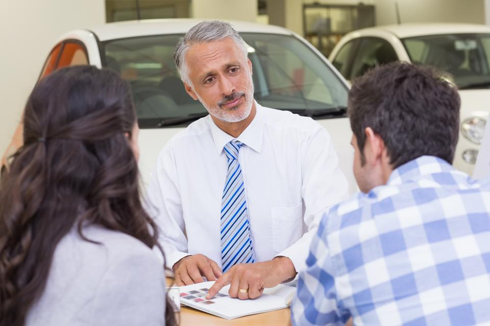 """""""Salesperson pointing something on booklet"""" stock image"""