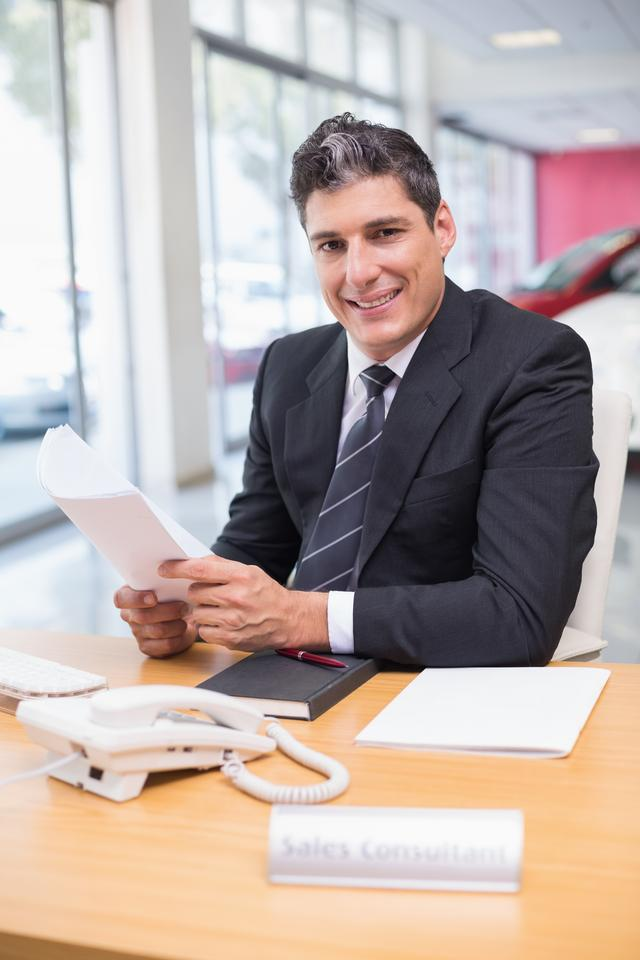 """""""Smiling salesperson holding a document"""" stock image"""