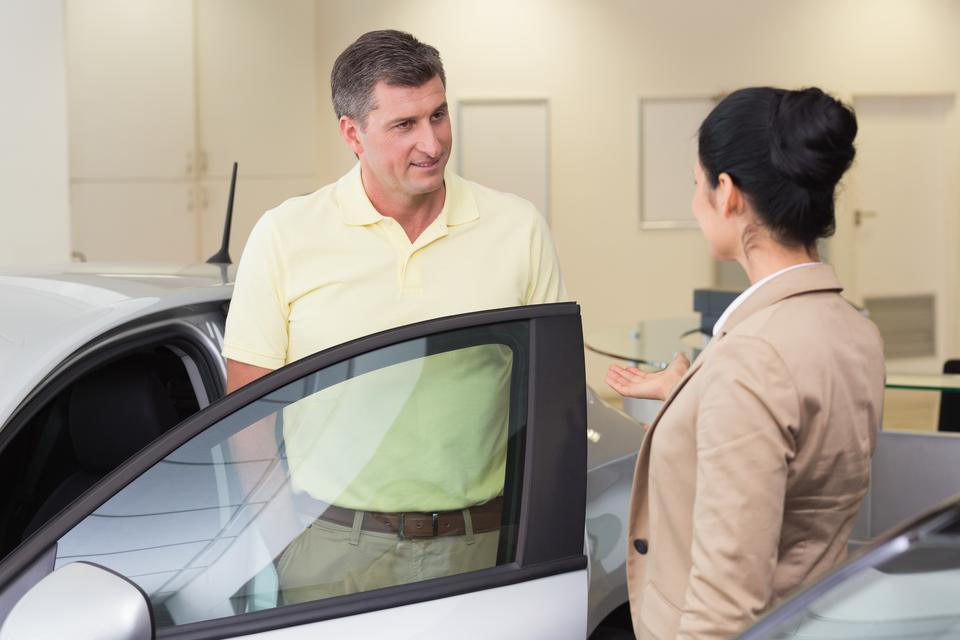 """""""Salesperson talking with her customer"""" stock image"""