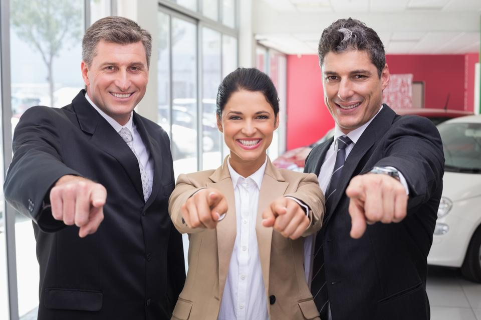 """""""Smiling business team pointing at camera"""" stock image"""