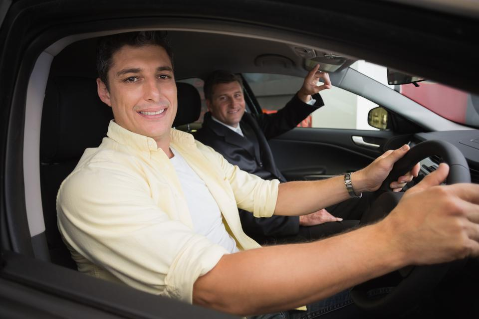 """""""Businessman pointing a car interior"""" stock image"""