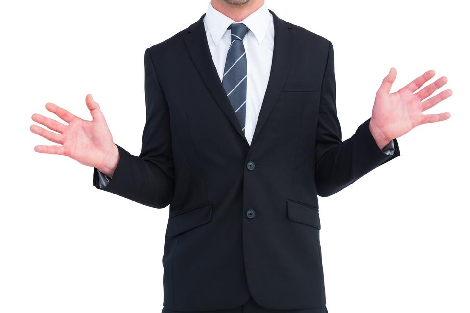 """Well dressed businessman with hands up"" stock image"