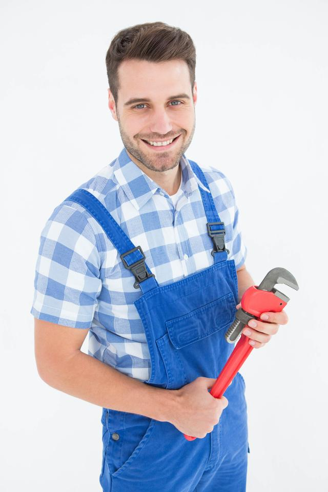 """Confident young male repairman holding monkey wrench"" stock image"