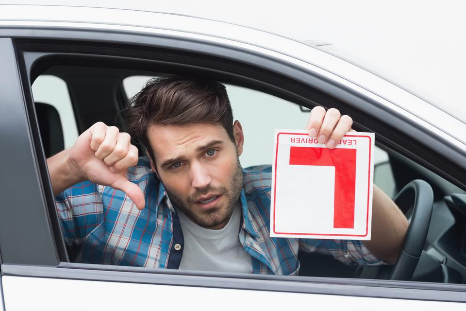"""""""Learner driver smiling and holding l plate"""" stock image"""