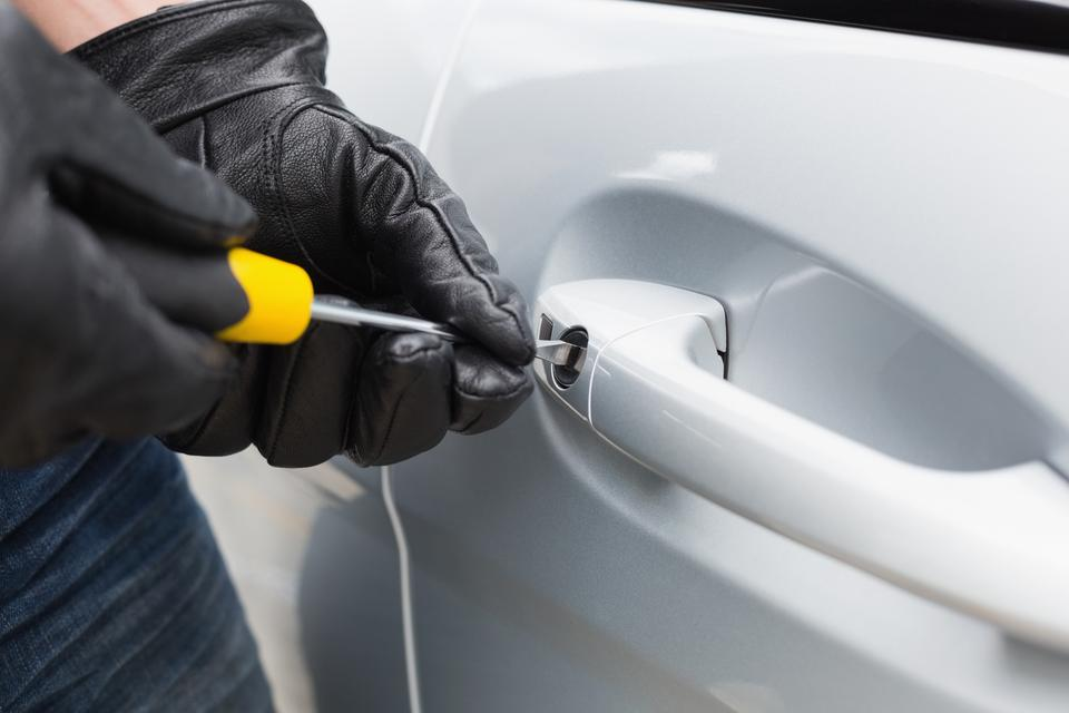 """""""Thief breaking into a car"""" stock image"""