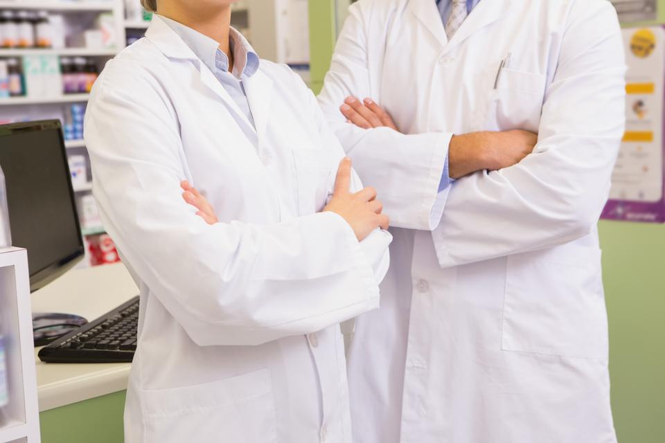 """Pharmacist and his trainee with arms crossed"" stock image"