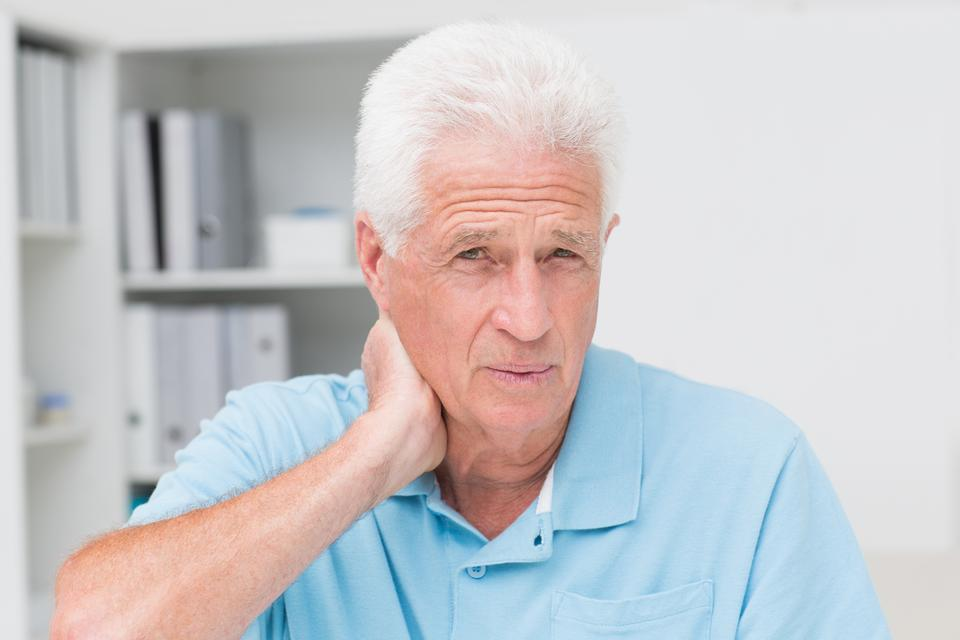 """""""Male patient suffering from neck ache"""" stock image"""