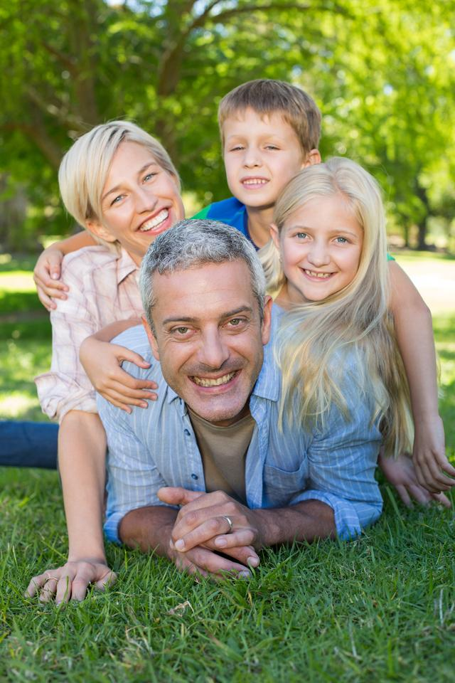 """""""Happy family smiling at the camera"""" stock image"""