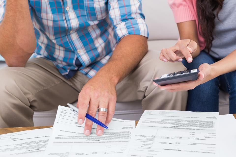 """""""Couple calculating finances at home"""" stock image"""