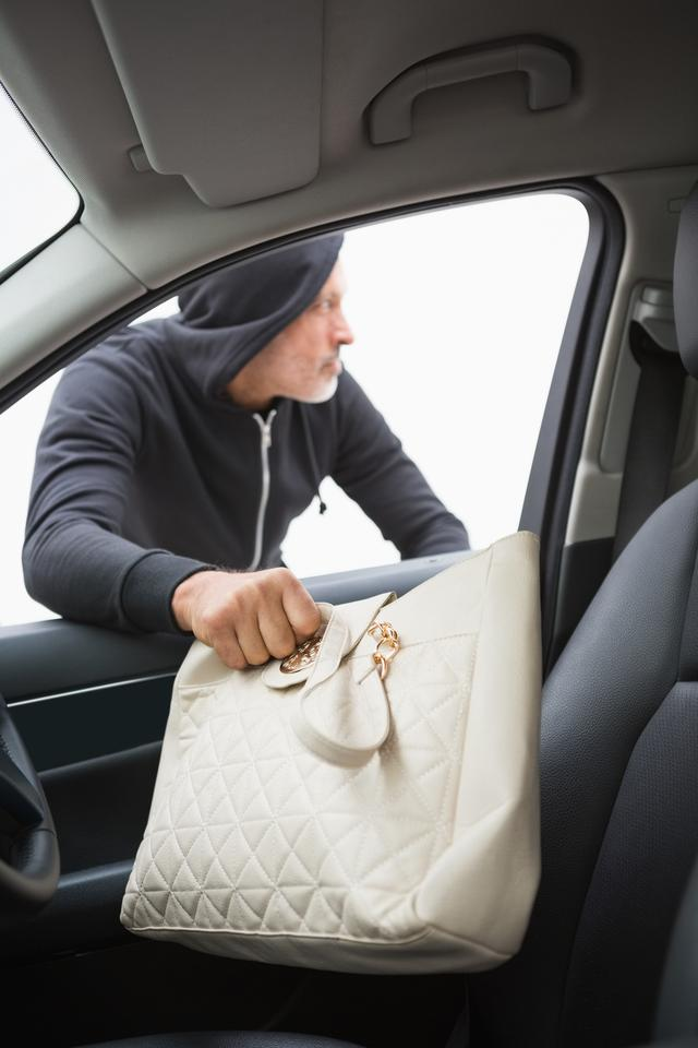 """""""Thief breaking into car and stealing hand bag"""" stock image"""