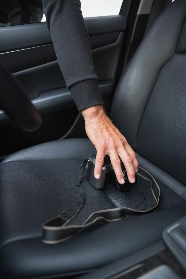 """""""Thief breaking into car and stealing"""" stock image"""