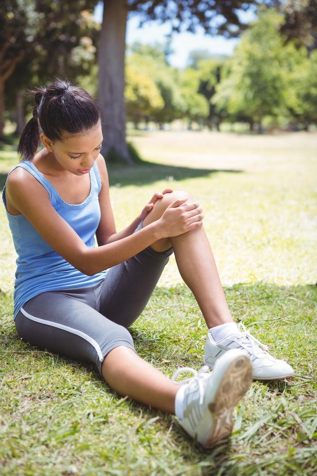 """""""Fit woman with injured knee"""" stock image"""