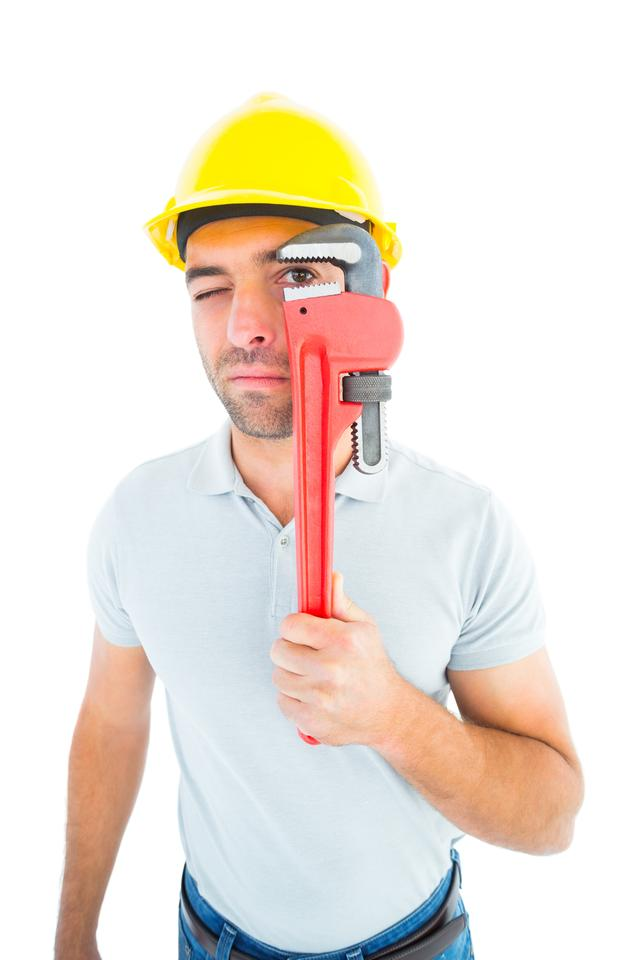 """Manual worker looking through monkey wrench"" stock image"