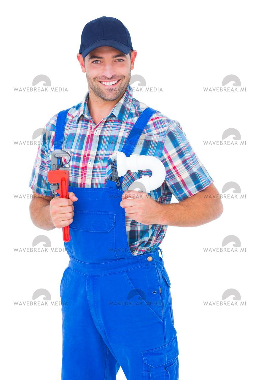 """Happy male plumber holding monkey wrench and sink pipe"" stock image"