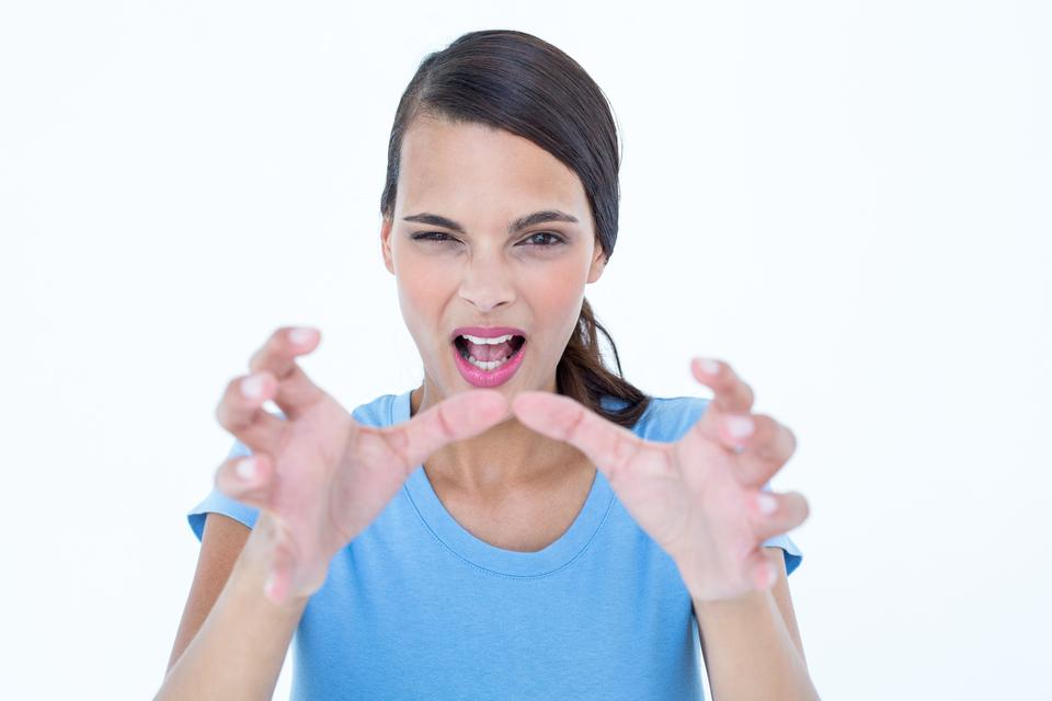 """""""Furious woman with hands up"""" stock image"""
