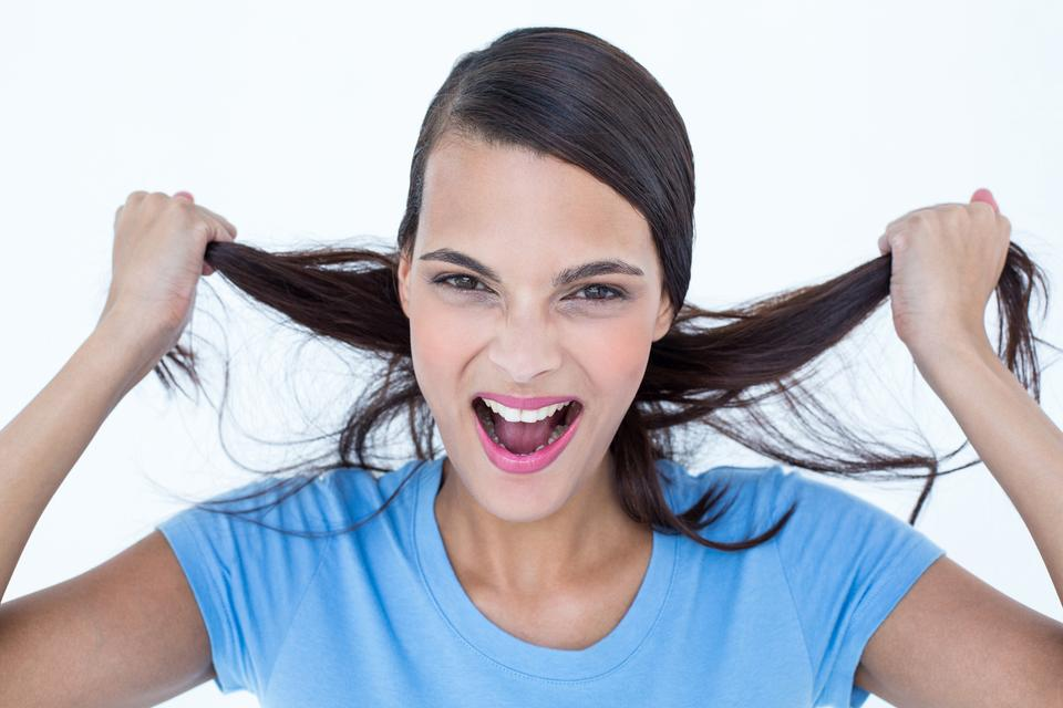 """""""Furious woman pulling her hair"""" stock image"""