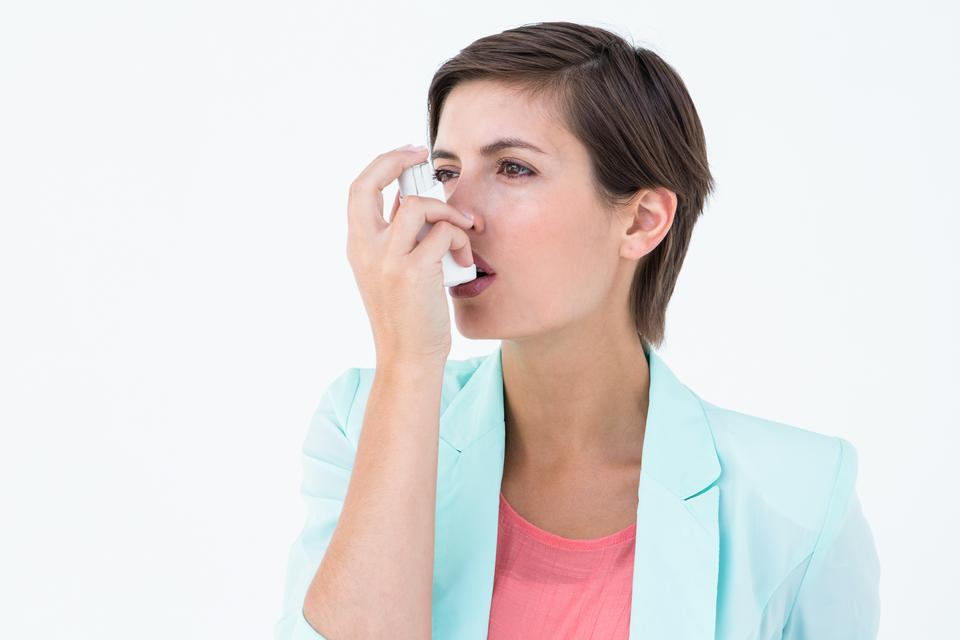 """""""Pretty woman using her inhaler"""" stock image"""