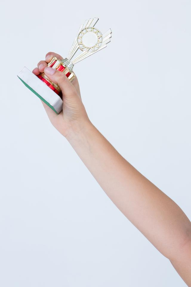"""""""Woman holding a trophy"""" stock image"""