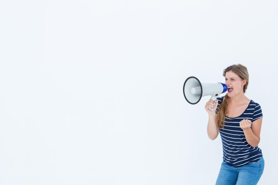 """Woman shouting through a loudspeaker"" stock image"