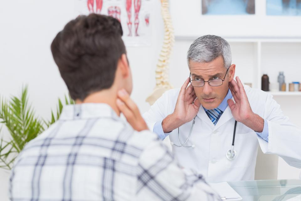 """""""Doctor examining patient with neck ache"""" stock image"""