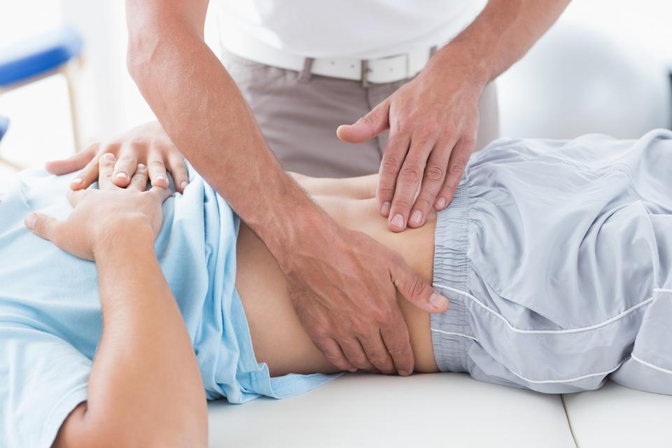 """""""Doctor examining his patient stomach"""" stock image"""