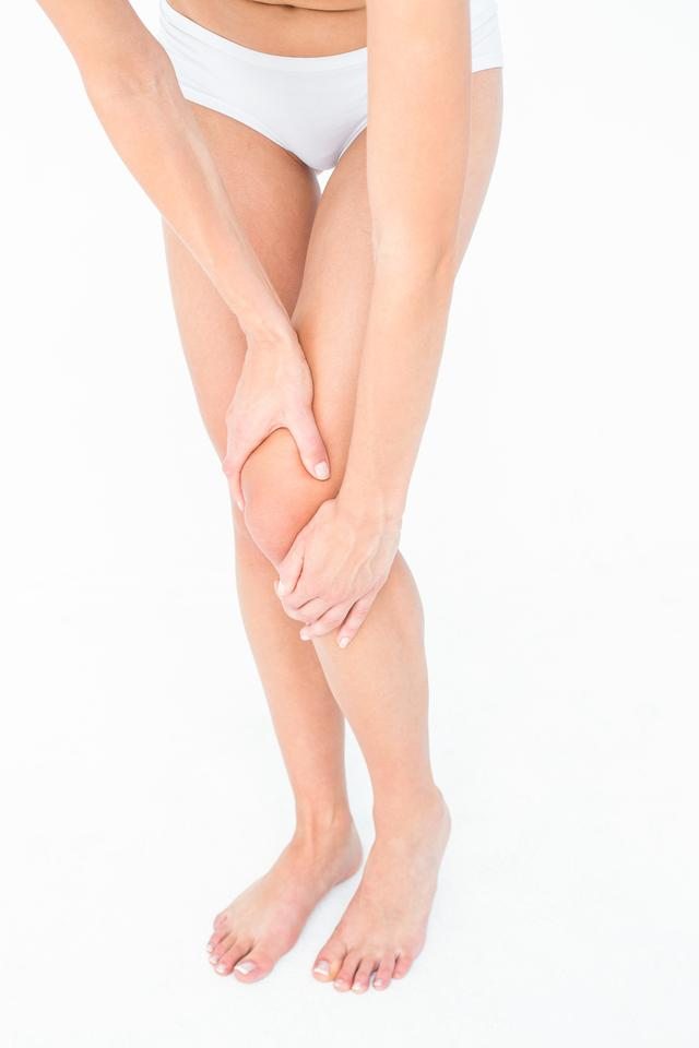 """""""Woman with knee pain"""" stock image"""