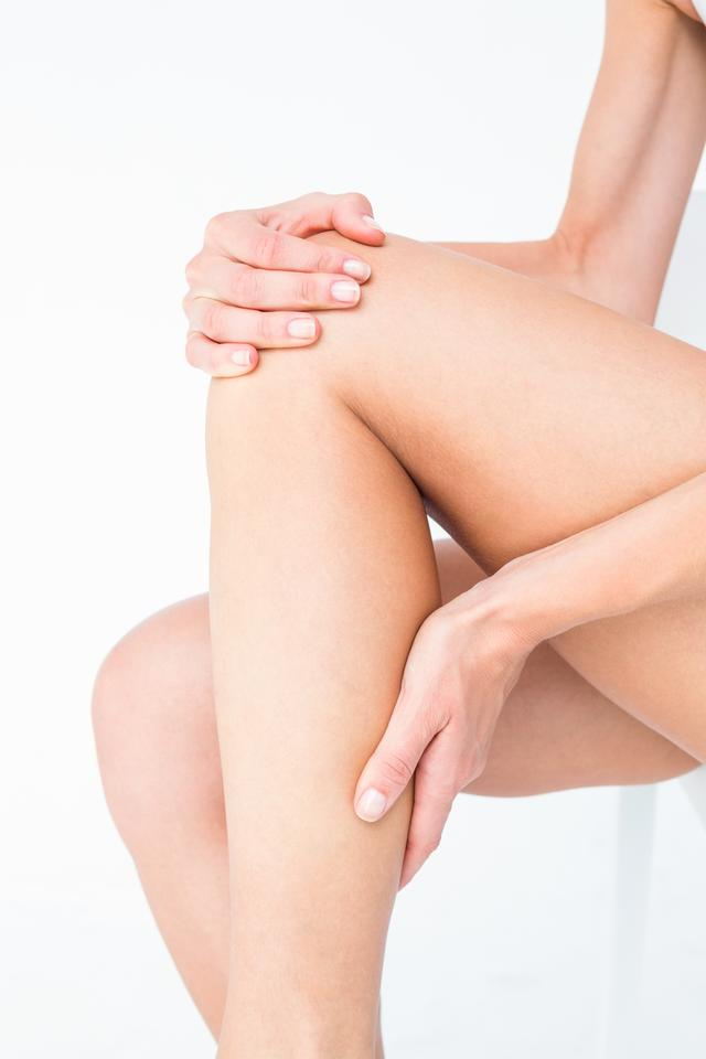 """""""Fit woman with knee pain"""" stock image"""