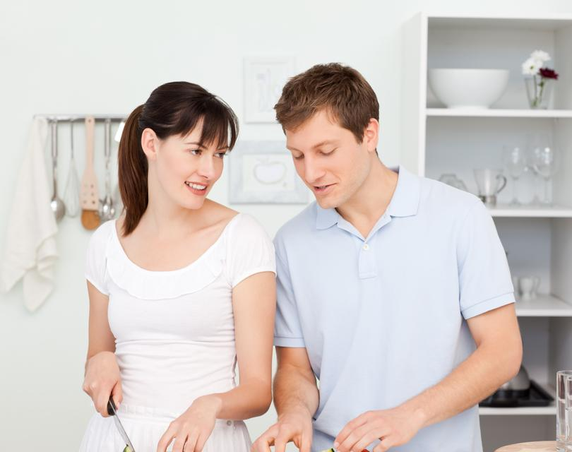 """""""Lovers cooking together in the kitchen"""" stock image"""