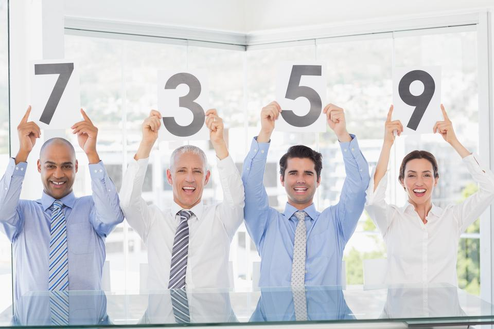 """""""Smiling business team showing paper with rating"""" stock image"""