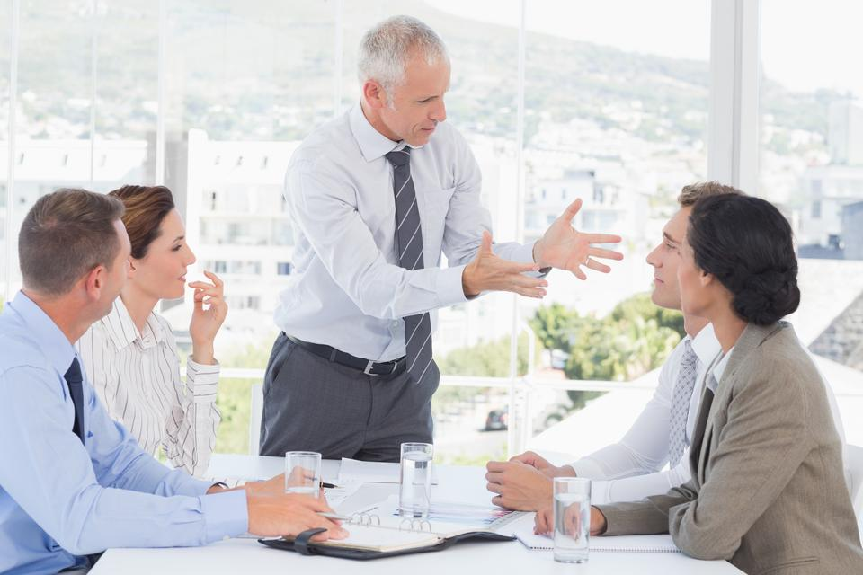 """Businessman yelling at his team"" stock image"