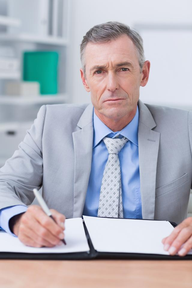 """Unhappy businessman looking at camera"" stock image"