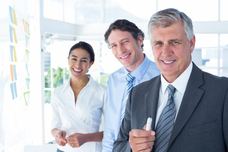 """""""Smiling business people brainstorming together"""" stock image"""