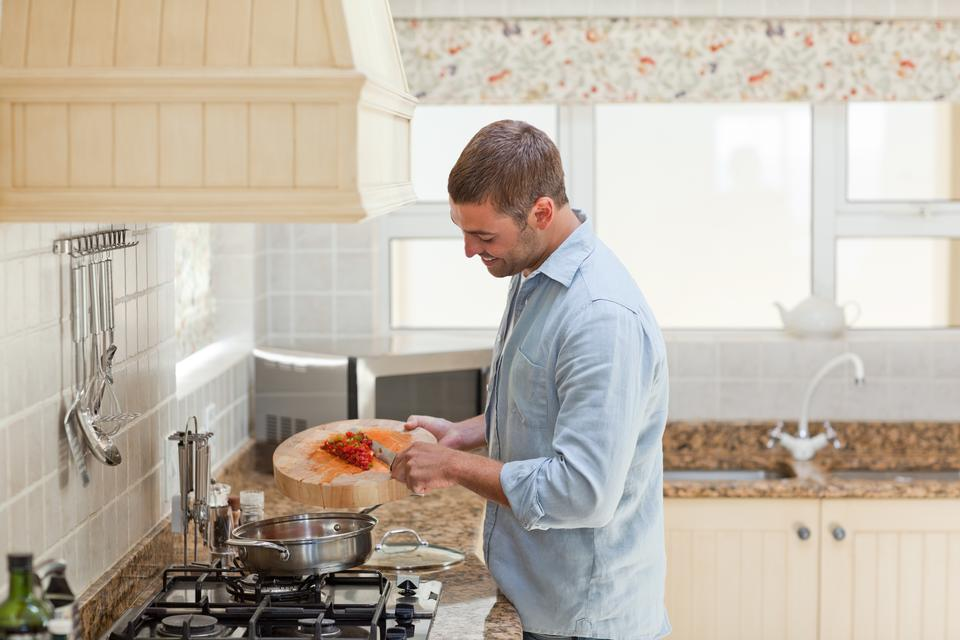 """""""Handsome man cooking in the kitchen"""" stock image"""