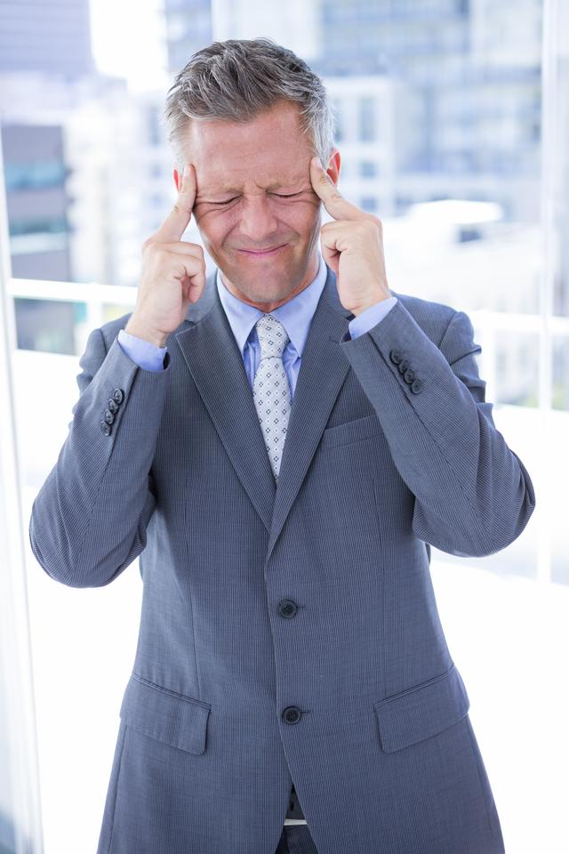 """Businessman having a headache"" stock image"