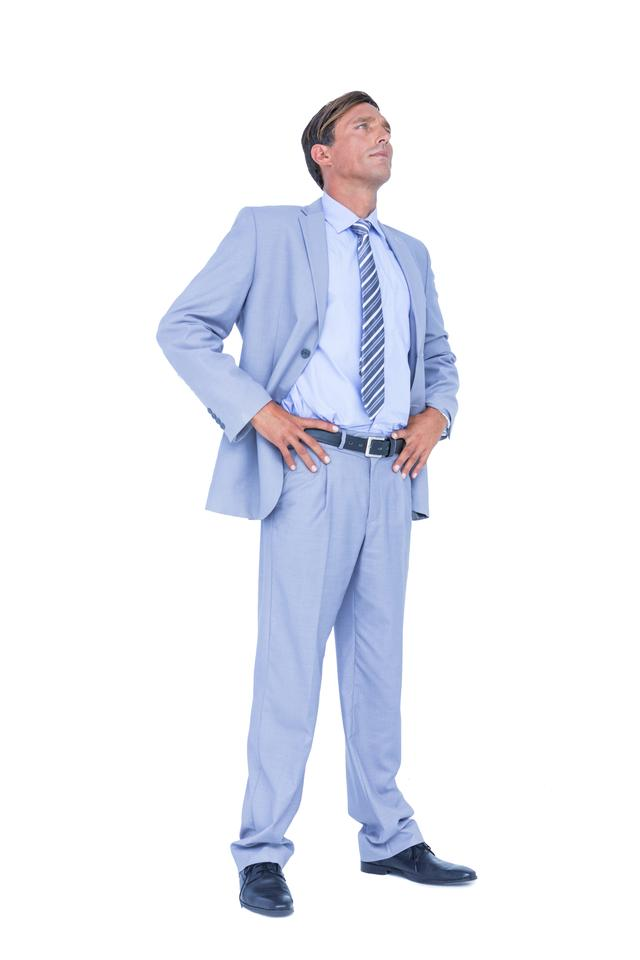 """businessman with hands on hip"" stock image"