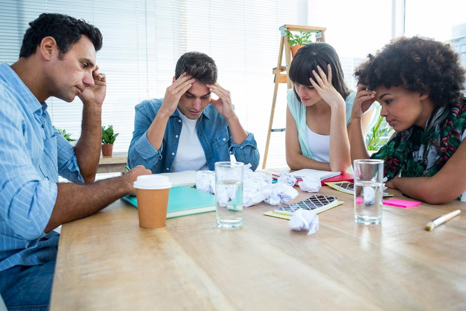 """""""Exhausted creative business team riled up"""" stock image"""