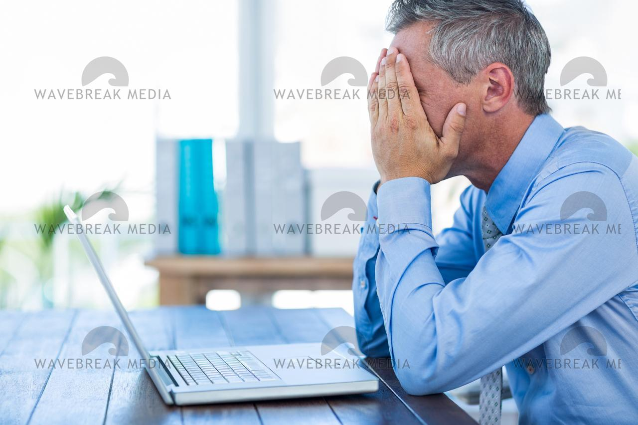 """""""Irritated businessman with hands on head"""" stock image"""